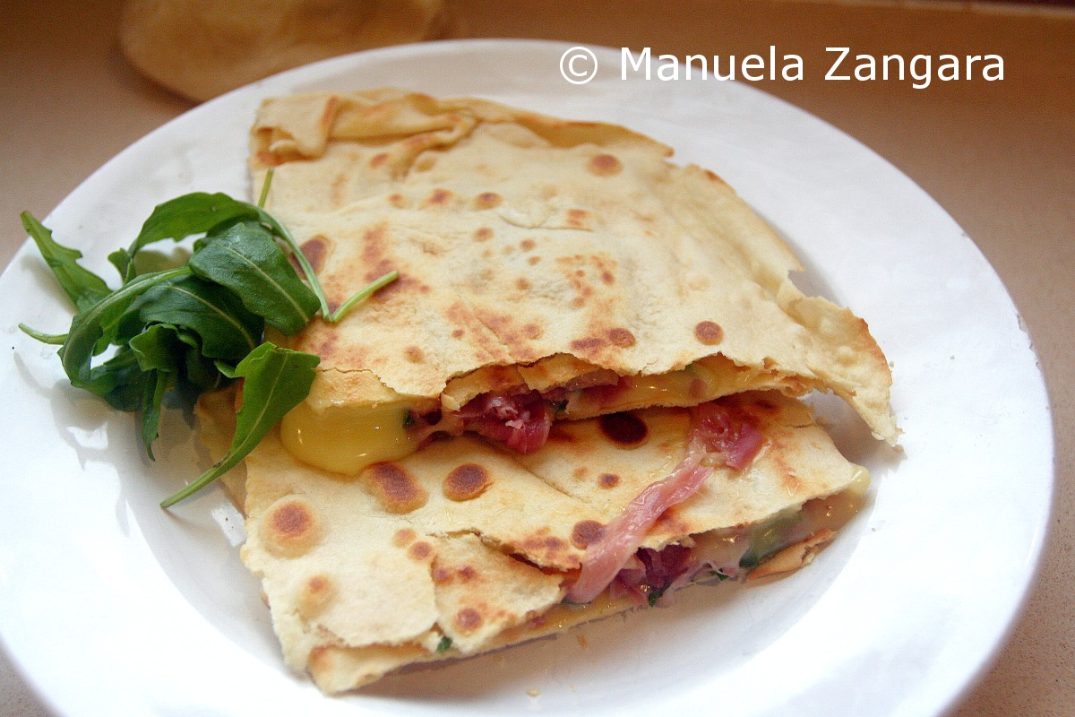 Homemade Piadina with prosciutto, stracchino and rocket