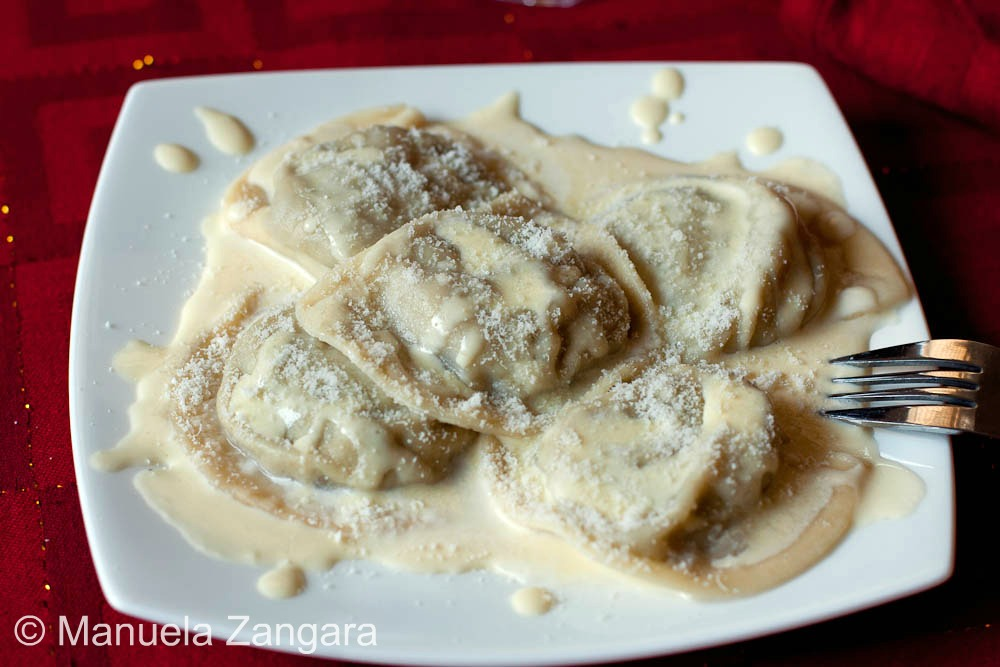 Artichoke and ricotta Mezzelune on a Parmigiano Reggiano fondue