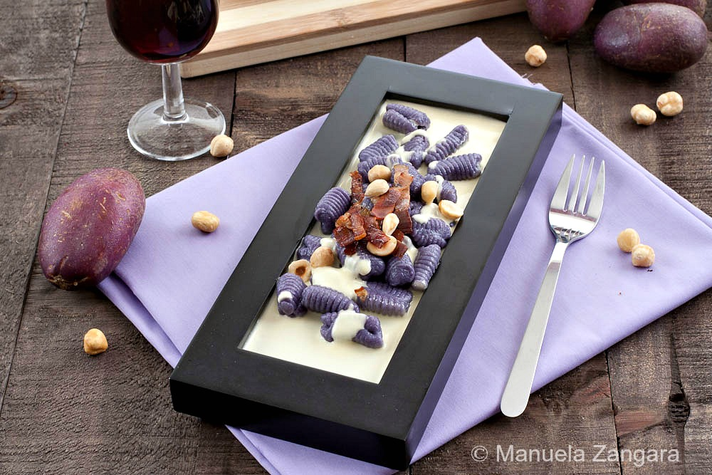 Purple Gnocchi on a Parmigiano Reggiano Fondue, Toasted Hazelnuts and Crunchy Speck