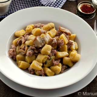 SAFFRON GNOCCHI WITH SAUSAGE AND PORCINI