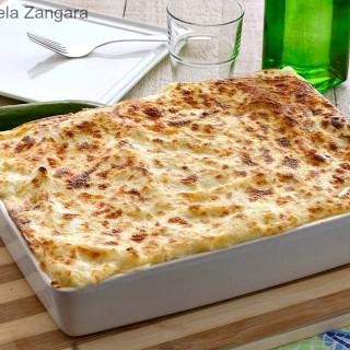 Lasagne with zucchini pesto, speck and smoked scamorza